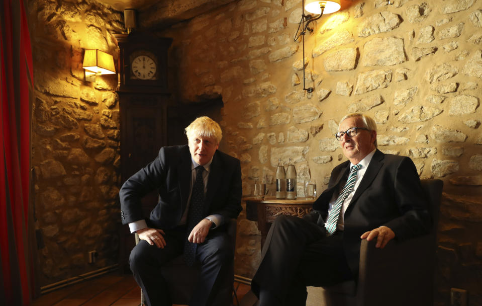European Commission President Jean-Claude Juncker, right, poses with British Prime Minister Boris Johnson prior to a meeting at a restaurant in Luxembourg, Monday, Sept. 16, 2019. British Prime Minister Boris Johnson was holding his first meeting with European Commission President Jean-Claude Juncker on Monday in search of a longshot Brexit deal. (AP Photo/Francisco Seco, Pool)