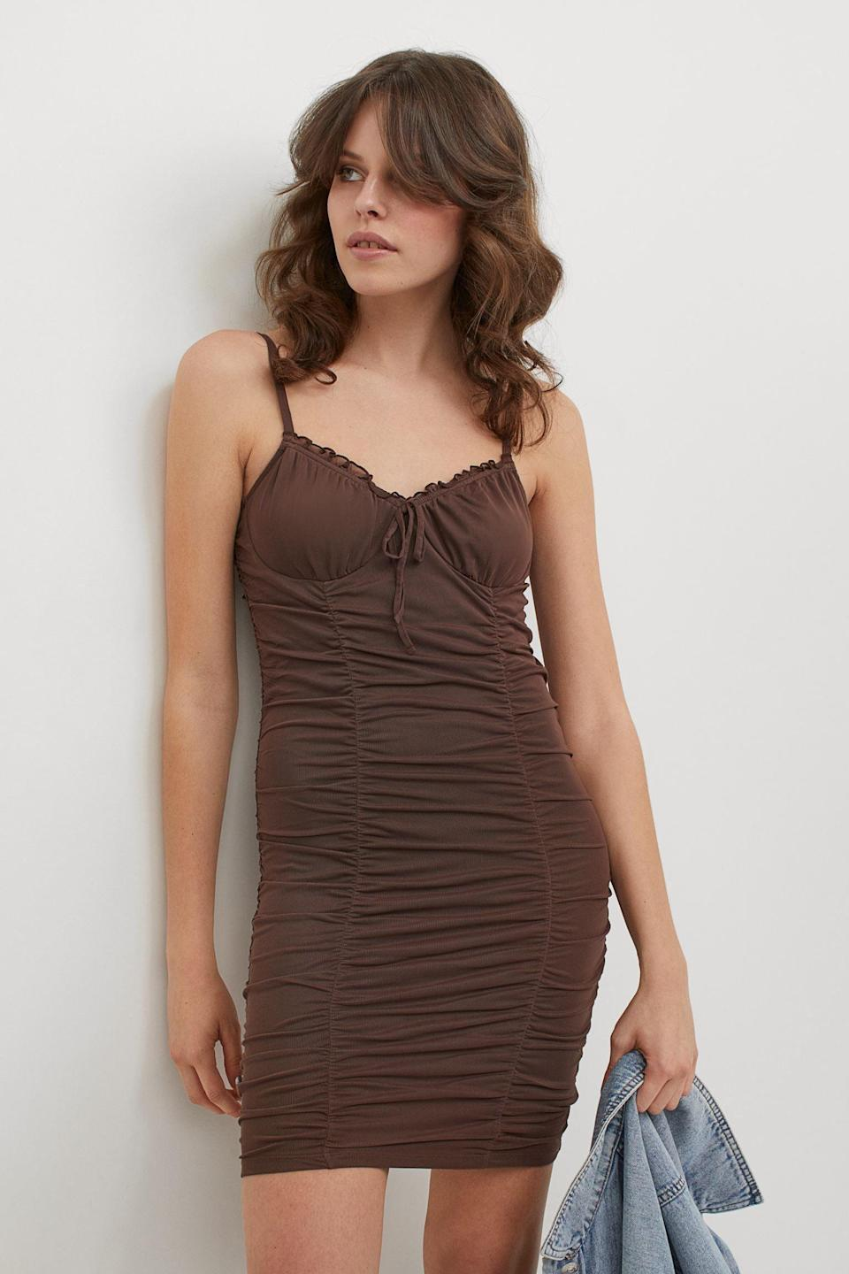 <p>This <span>Draped Dress</span> ($25) is sexy, but it can easily be dressed up (with heeled sandals) or down (with white sneakers and a denim jacket).</p>