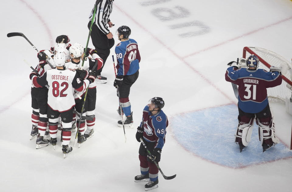 Arizona Coyotes celebrate a goal against the Colorado Avalanche during the first period of a first round NHL Stanley Cup playoff hockey series in Edmonton, Alberta, Friday, Aug. 14, 2020. (Jason Franson/The Canadian Press via AP)