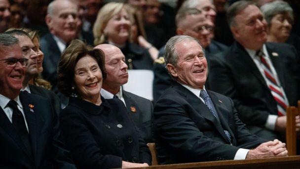 PHOTO: Jeb Bush, Laura Bush, and former President George W. Bush share a laugh as a story is told about former President George H.W. Bush during a State funeral at the National Cathedral, Dec. 5, 2018, in Washington. (Evan Vucci/AP)