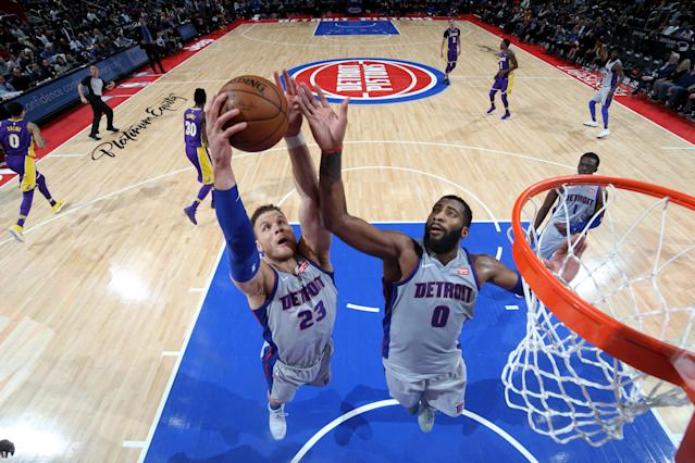 Blake Griffin and Andre Drummond will still be vying for rebounds in Detroit next year, but Stan Van Gundy won't be there to watch them. (Getty)