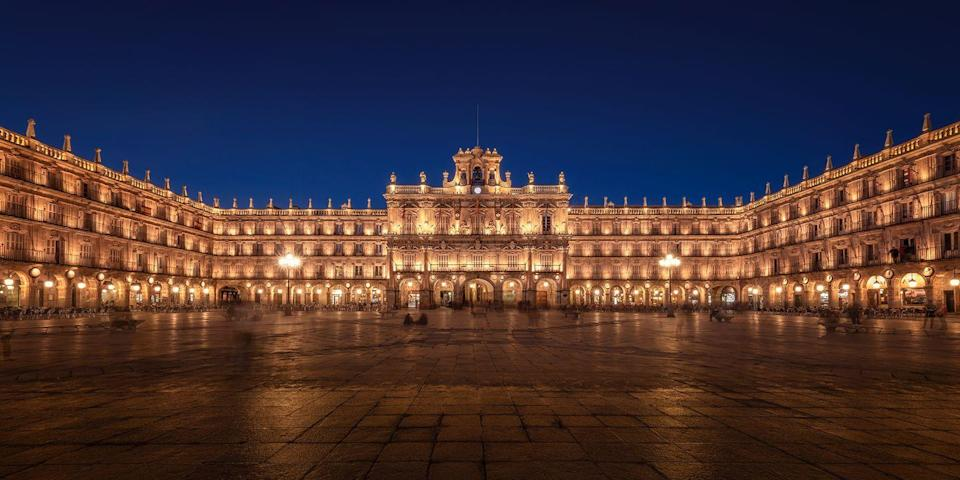 """<p>Salamanca (a 2.5-hour drive from Madrid) is home to one of the most beautiful squares in all of Spain, the <a href=""""https://www.tripadvisor.com/Attraction_Review-g187493-d313536-Reviews-Salamanca_s_Plaza_Mayor-Salamanca_Province_of_Salamanca_Castile_and_Leon.html"""" rel=""""nofollow noopener"""" target=""""_blank"""" data-ylk=""""slk:Plaza Mayor"""" class=""""link rapid-noclick-resp"""">Plaza Mayor</a>. Surrounding this grand central square in the Old Town are elegant Baroque-style buildings, featuring graceful arches and balustrades. One of the best times to visit the plaza is in the evening, when the buildings are illuminated, creating an almost magical effect. </p>"""