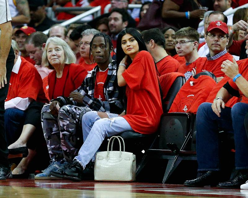 Kylie Jenner, in home team colors, at a Houston Rockets game with rumored boyfriend Travis Scott in Houston, Texas (the rapper's hometown), April 2017.