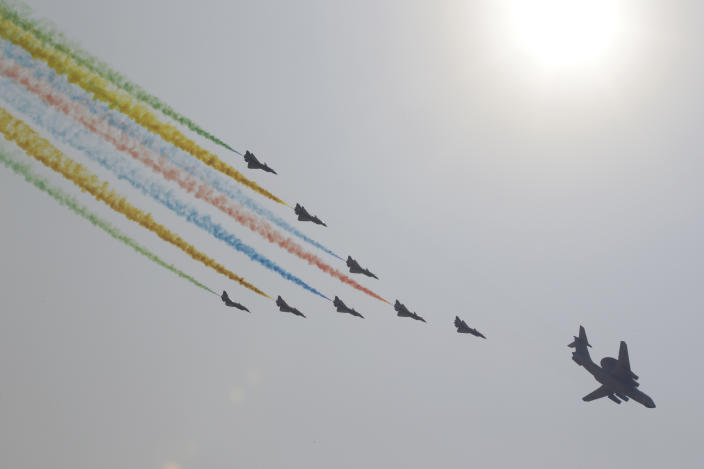 Military aircraft fly in formation over Tiananmen Square during the military parade marking the 70th founding anniversary of People's Republic of China, on its National Day in Beijing, China October 1, 2019. (Photo: Jason Lee/Reuters)