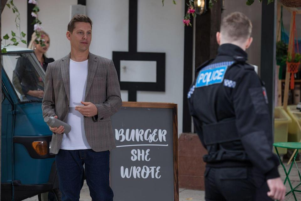 <p>He is trying to deal with the blackmailer and has teamed up with James for help.</p>