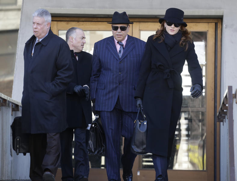 From left, retired Judge Daniel Locallo, walks with defense lawyers for Drew Peterson, Steve Greenberg, Joe Lopez, and Lisa Lopez, as they leave the Will County Courthouse Wednesday, Feb. 20, 2013, in Joliet, Ill., for lunch during the second day of a hearing in the former suburban Chicago police officer's request for a new trial. During the hearing Locallo spoke as the defense sought to bolster arguments that Peterson deserved a retrial on charges he murdered his third wife, Kathleen Savio. Peterson's attorneys contend his former lead trial attorney, Joel Brodsky, botched his case. Locallo told the judge that Brodsky made a major mistake by calling one witness whose testimony badly backfired on the defense. (AP Photo/M. Spencer Green)