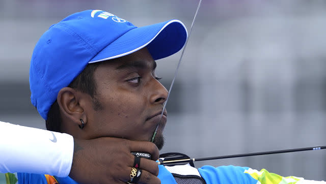 India's Atanu Das in action on Monday. While Indian men's archery team beat Kazakhstan 6-2 to setup a quarterfinal clash against Republic of Korea, they faltered 0-6 in the last eight stage. AP
