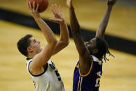 Iowa center Luka Garza shoots over Western Illinois forward Tamell Pearson, right, during the first half of an NCAA college basketball game, Thursday, Dec. 3, 2020, in Iowa City, Iowa. (AP Photo/Charlie Neibergall)