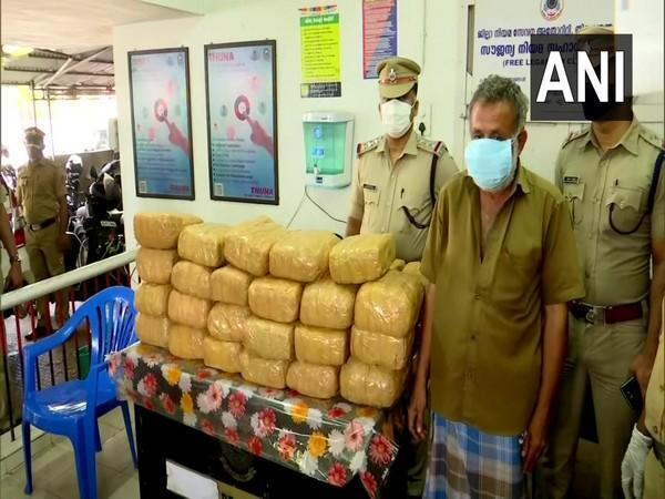 The arrested person along with the 110 kgs of ganja that has been seized by the city police (Photo/ANI)