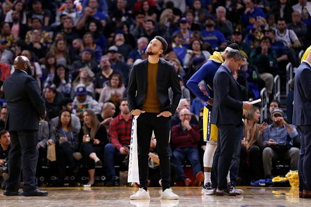 After breaking his hand in October, Steph Curry is still expected to be evaluated again on February 1. (Lachlan Cunningham/Getty Images)
