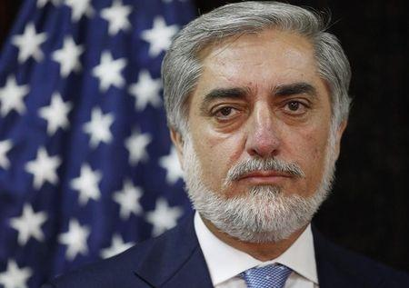 Afghanistan's presidential candidate Abdullah listens to U.S. Secretary of State Kerry during a photo opportunity at the start of a meeting at the U.S. embassy in Kabul