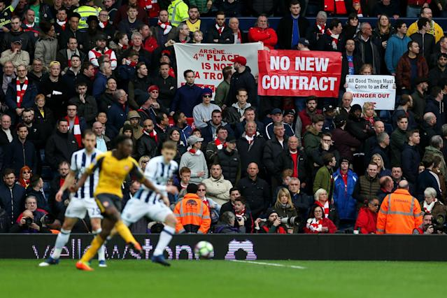 Arsenal fans display banners during the Premier League match between West Bromwich Albion and Arsenal at The Hawthorns