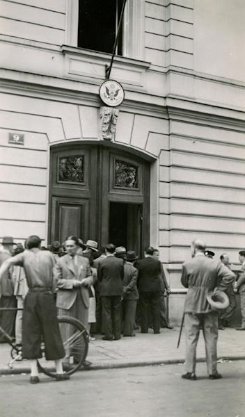 """In this 1938 photo provided by the Museum of Jewish Heritage - A Living Memorial to the Holocaust, prospective immigrants line up outside the U.S. consulate in Vienna after the German annexation of Austria. An exhibition opening at the museum on Tuesday, May 21, 2013 called """"Against All Odds: American Jews and the Rescue of Europe's Refugees, 1933-1941,"""" documents efforts by American Jews to get refugees out of Nazi-era Europe despite strict immigration quotas in the U.S. (AP Photo/Museum of Jewish Heritage/Courtesy of the Franklin D. Roosevelt Presidential Library & Museum)"""