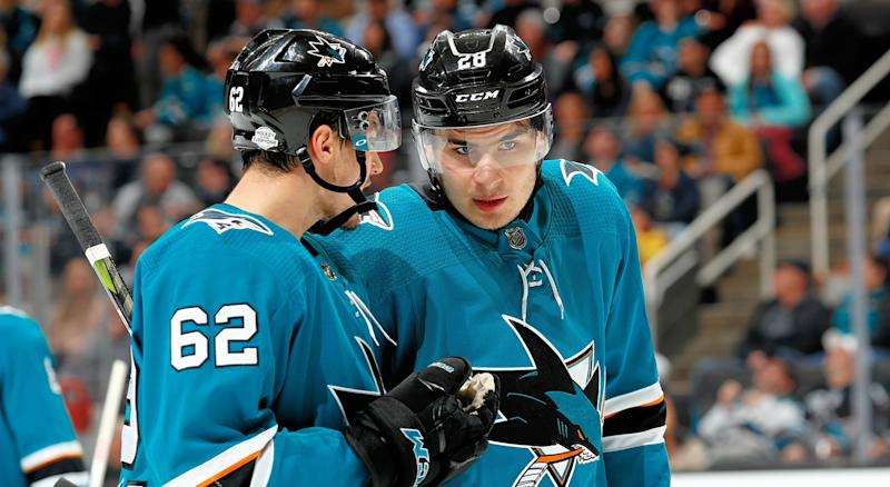 SAN JOSE, CA - FEBRUARY 13: Kevin Labanc #62 and Timo Meier #28 of the San Jose Sharks chat during a NHL game against the Arizona Coyotes at SAP Center on February 13, 2018 in San Jose, California. (Photo by Scott Dinn/NHLI via Getty Images)