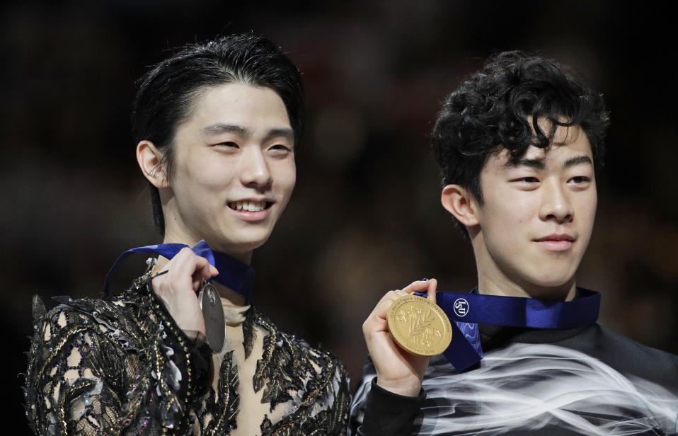 "FILE - In this Saturday, March 23, 2019 file photo, Japan's Yuzuru Hanyu and Nathan Chen from the United States display their silver and gold medals respectively during the men's free skating routine during the ISU World Figure Skating Championships at Saitama Super Arena in Saitama, north of Tokyo. As Nathan Chen seeks a third straight World Figure Skating Championships title, something no American has achieved since Scott Hamilton got his fourth in a row in 1984, he has two major challenges in front of him. One is two-time Olympic gold medalist Yuzuru Hanyu of Japan, who Chen calls ""the benchmark."" The other is idleness in major competitions forced by the coronavirus pandemic. ((AP Photo/Andy Wong, File)"