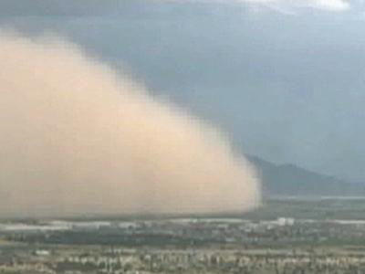 A massive dust storm covered much of Phoenix late Sunday, drastically reducing visibility on area highways. (July 30)