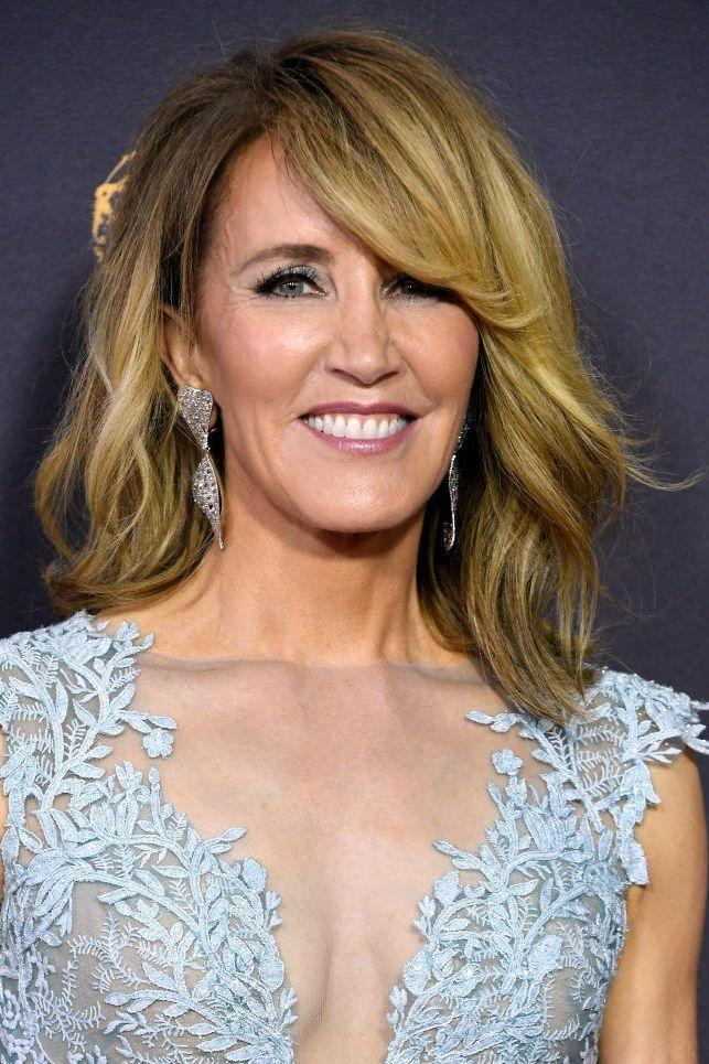 """<p>A little swoop at the ends of your side-swept bangs create a <a href=""""https://www.goodhousekeeping.com/beauty/hair/g2703/vintage-hair-makeup-trends-now/"""" rel=""""nofollow noopener"""" target=""""_blank"""" data-ylk=""""slk:timeless look"""" class=""""link rapid-noclick-resp"""">timeless look</a> without feeling costume-y. Here's proof. </p>"""