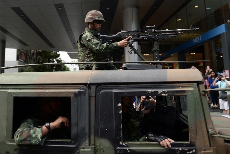 Soldiers deploy a jeep mounted with a machine gun at a shopping mall after anti-coup protesters opposing the junta turned up in downtown Bangkok on June 1, 2014