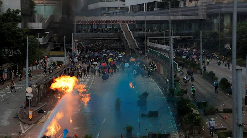 Riot police spray blue-coloured water during a protest on China's National Day in Hong Kong, China October 1, 2019.