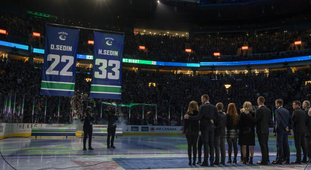 Daniel and Henrik Sedin, two of the greatest players to ever lace 'em up for the Vancouver Canucks, watched their numbers go into the rafters on Wednesday night. (Photo by Ben Nelms/Getty Images)