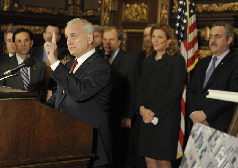 Minnesota Gov. Mark Dayton, left, emphasizes that an agreement for a new Minnesota Vikings NFL football stadium will require no general fund tax dollars as Vikings owner Zygi Wilf, right, and other lawmakers listen during a news conference Thursday, March 1, 2012 in St. Paul , Minn. where it was announced that a site for a new Vikings football stadium along with a financing agreement had been reached. (AP Photo/Jim Mone)