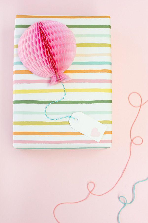 """<p>Honeycomb balls lend a touch of whimsy to any baby shower or kids' birthday gift. </p><p>Get the tutorial at <a href=""""https://studiodiy.com/diy-honeycomb-balloon-gift-toppers/"""" rel=""""nofollow noopener"""" target=""""_blank"""" data-ylk=""""slk:Studio DIY"""" class=""""link rapid-noclick-resp"""">Studio DIY</a>.</p><p><a class=""""link rapid-noclick-resp"""" href=""""https://www.amazon.com/LG-Free-Handmade-Honeycomb-Decoration-Birthday/dp/B074C2VX5T?tag=syn-yahoo-20&ascsubtag=%5Bartid%7C10072.g.34015639%5Bsrc%7Cyahoo-us"""" rel=""""nofollow noopener"""" target=""""_blank"""" data-ylk=""""slk:SHOP HONEYCOMB BALLS"""">SHOP HONEYCOMB BALLS</a> </p>"""