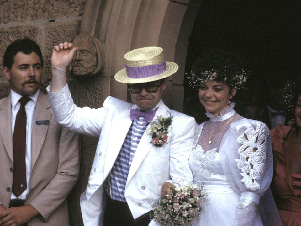John and Blauel on their wedding day in 1984 (Getty)