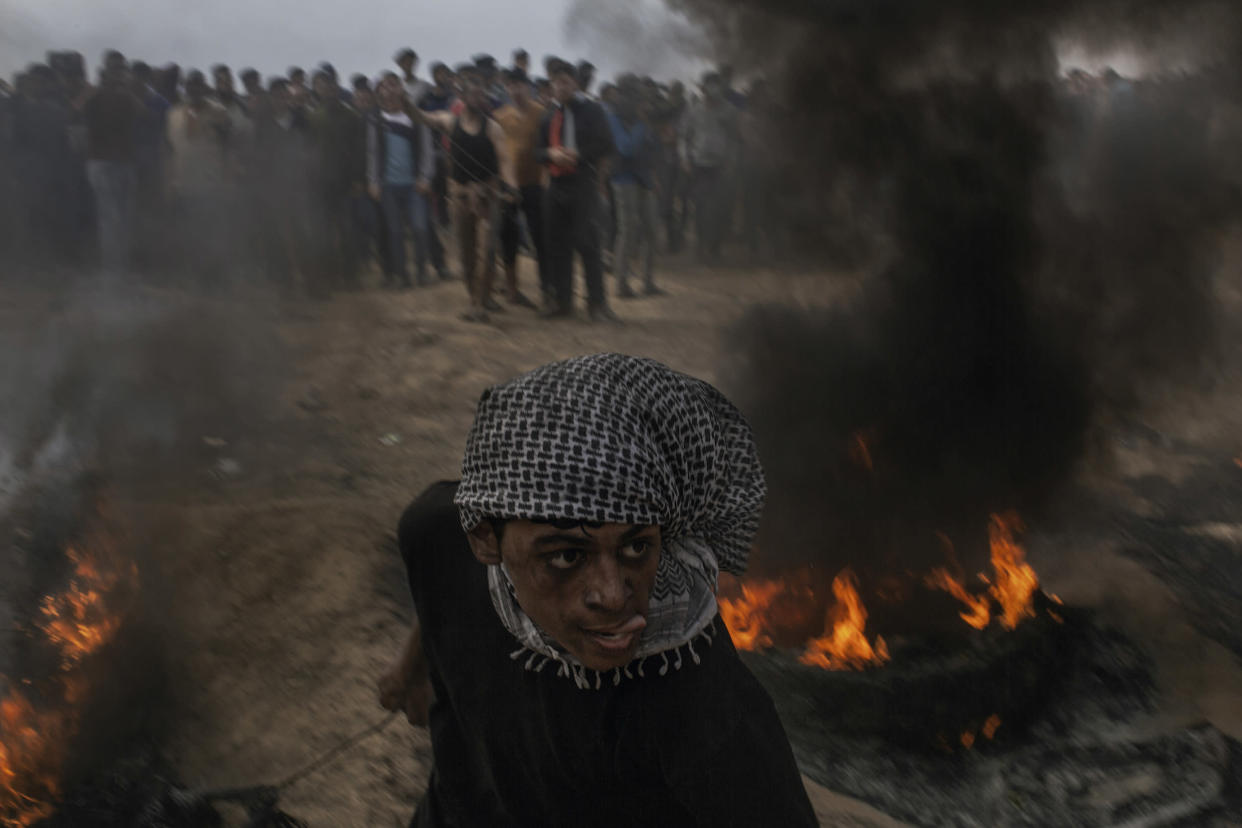 """A Palestinian demonstrator is seen during the """"Great March of Return"""" protests at Eastern Gaza City's border on April 20, 2018. The """"Great March of Return"""" is a public wave of protests, a civil movement aimed to break the Israeli siege of the Gaza Strip and to uphold the Palestinian right to return to their homeland. (Photo: Fabio Bucciarelli for Yahoo News)"""