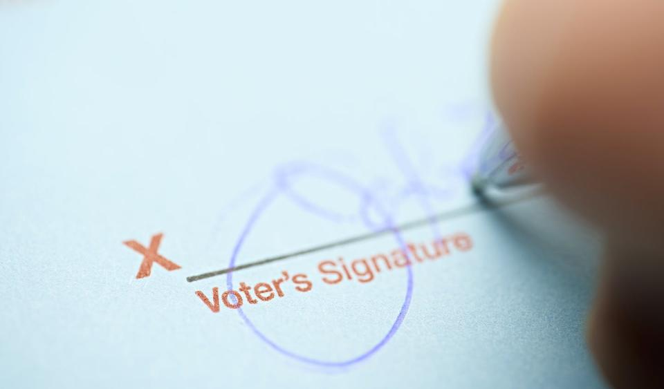 A person signs their name.