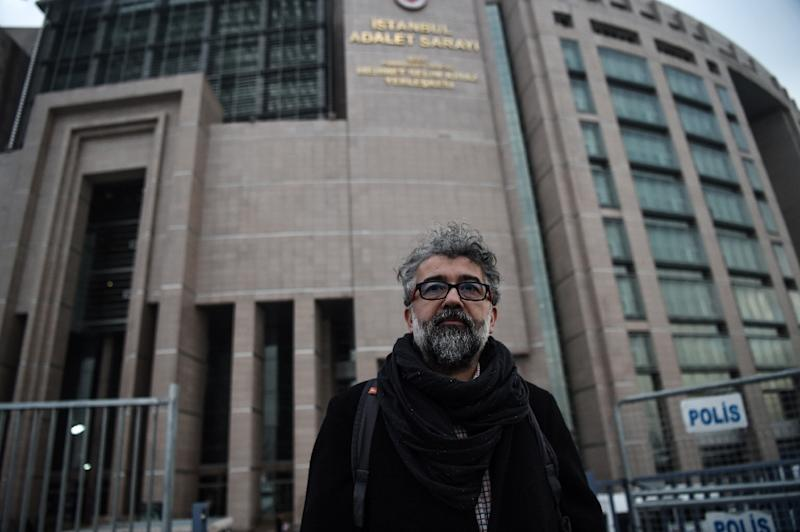 Turkey representative for Reporters Without Borders (RSF) Erol Onderoglu told reporters outside the court they risked 14 years and six months in jail if convicted (AFP Photo/Ozan Kose)