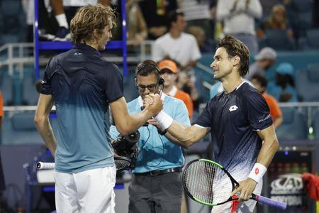 Mar 23, 2019; Miami Gardens, FL, USA; David Ferrer of Spain (R) shakes hands with Alexander Zverev of Germany (L) after their match in the second round of the Miami Open at Miami Open Tennis Complex. Mandatory Credit: Geoff Burke-USA TODAY Sports