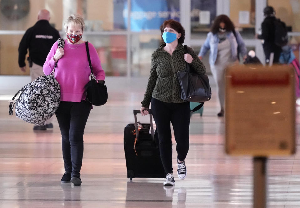 To prevent the spread of Covid-19, travelers wear masks at Love Field Tuesday, March 2, 2021, in Dallas. (AP Photo/LM Otero)