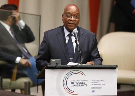 S.Africa's Zuma admits he is 'implicated' in graft report