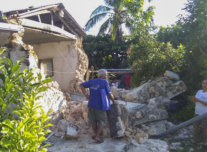A resident looks at damaged houses in Itbayat town, Batanes islands, northern Philippines following the earthquakes Saturday, July 27, 2019. Two strong earthquakes hours apart struck a group of sparsely populated islands in the Luzon Strait in the northern Philippines early Saturday. (Agnes Salengua Nico via AP)