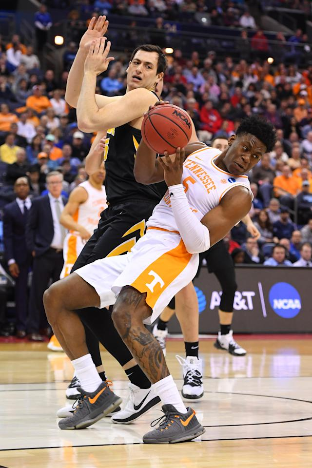 <p>Admiral Schofield #5 of the Tennessee Volunteers grabs a rebound away from Ryan Kriener #15 of the Iowa Hawkeyes in the second round of the 2019 NCAA Men's Basketball Tournament held at Nationwide Arena on March 24, 2019 in Columbus, Ohio. (Photo by Jamie Schwaberow/NCAA Photos via Getty Images) </p>