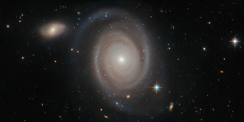 The spiral galaxy NGC 1706 may look a bit isolated drifting through the cosmos in this Hubble Space Telescope image, but this lonely galaxy has no shortage of neighbors. NGC 1706 belongs to a group of dozens of galaxies, all of which are held together by their mutual gravitational pull.