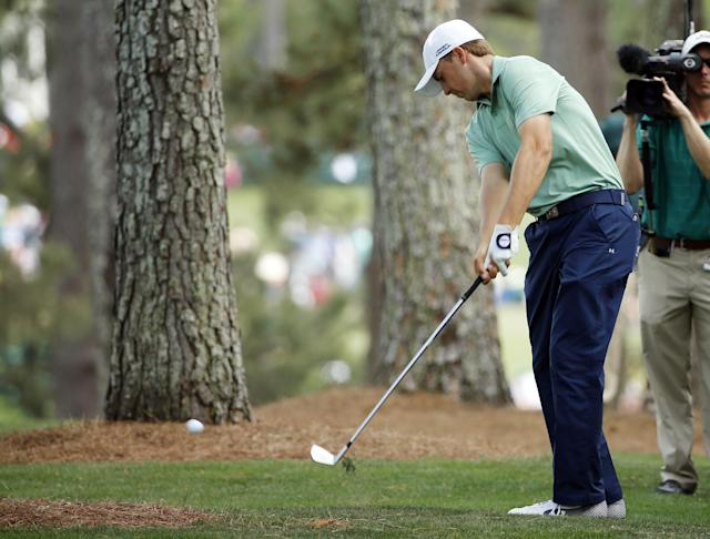Jordan Spieth hits out of the rough off the first fairway during the fourth round of the Masters golf tournament Sunday, April 13, 2014, in Augusta, Ga. (AP Photo/David J. Phillip)