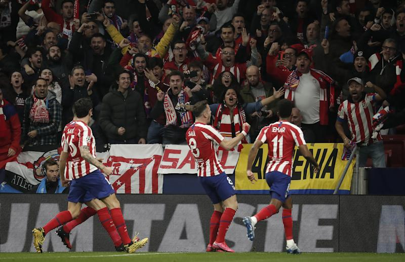 Saul Niguez (C) celebrates towards the crowd after scoring a goal for Atletico Madrid.