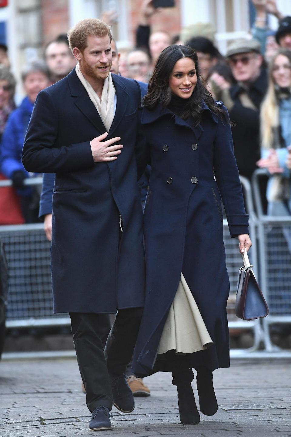 <p>The double-breasted military maxi coat by American outerwear label Mackage is an old favourite of Markles. She's been photographed wearing it on a number of occasions, while arriving in and leaving Heathrow. [Photo: Getty] </p>