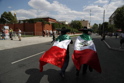 Mexico fans wear national flags and sombreros as they walk ahead of a group F match between Germany and Mexico at the 2018 soccer World Cup in the Luzhniki Stadium in Moscow, Russia, Sunday, June 17, 2018. (AP Photo/Eduardo Verdugo)