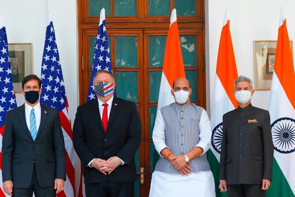 US Secretary of State Mike Pompeo (2nd L), US Secretary of Defence Mark Esper (L), India's Defence Minister Rajnath Singh (2nd R) and India's Foreign Minister Subrahmanyam Jaishankar pose for pictures before their meeting at Hyderabad House in New Delhi on October 27, 2020.