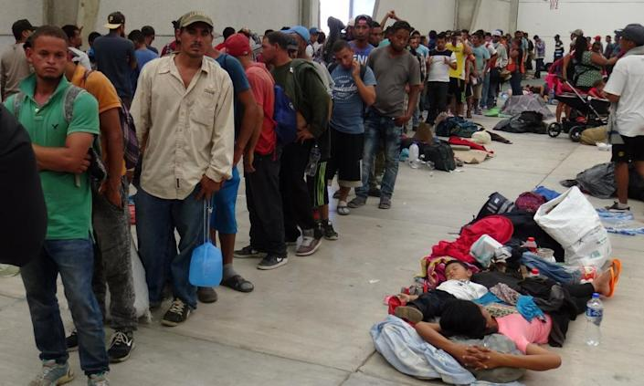 Central American migrants gather before continuing their journey to the US in Ixtepec, Mexico.
