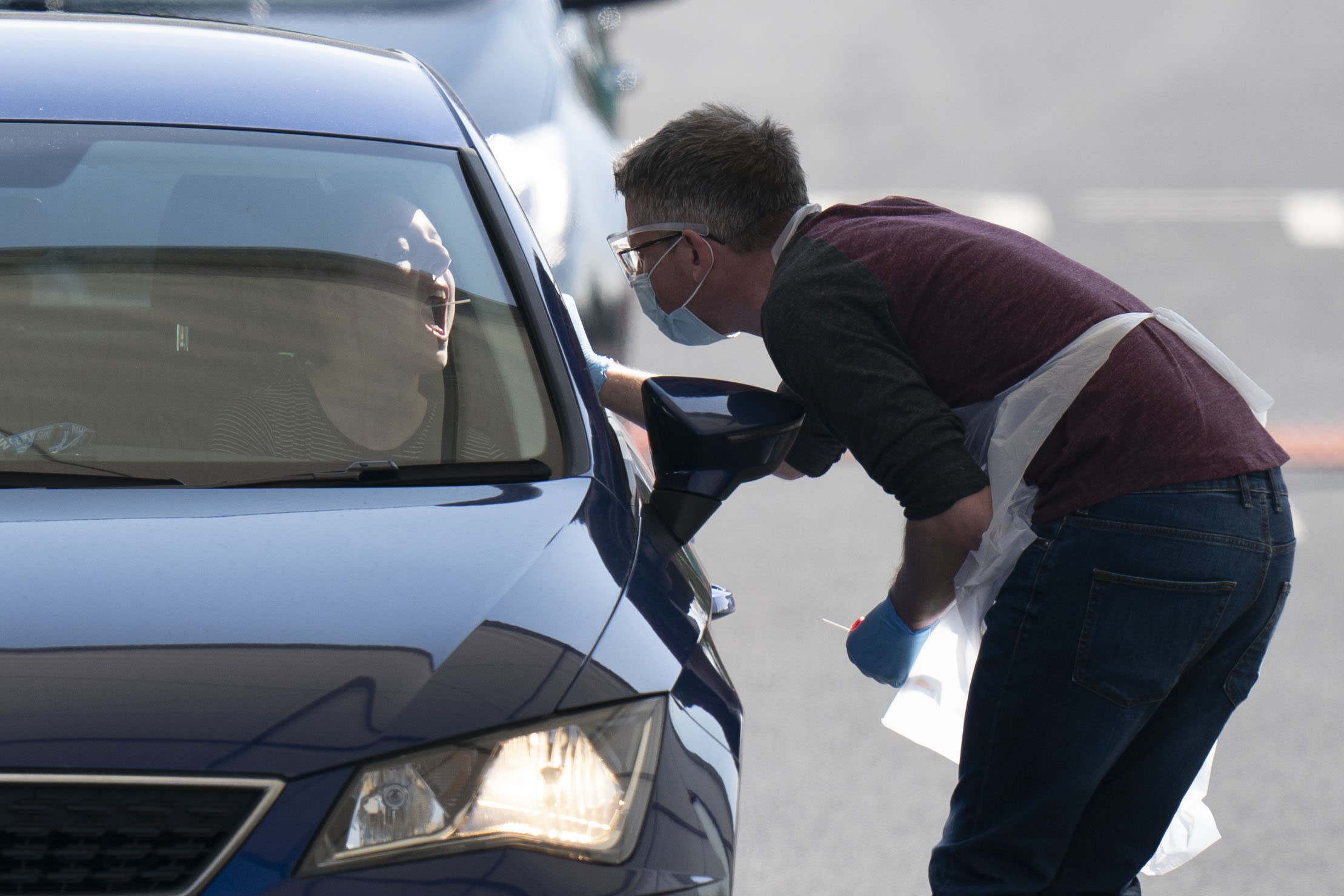 MANCHESTER, April 8, 2020 -- A medic takes samples from a person at a drive-thru COVID-19 testing site in Manchester, Britain, on April 8, 2020. (Photo by Jon Super/Xinhua via Getty) (Xinhua/ via Getty Images)