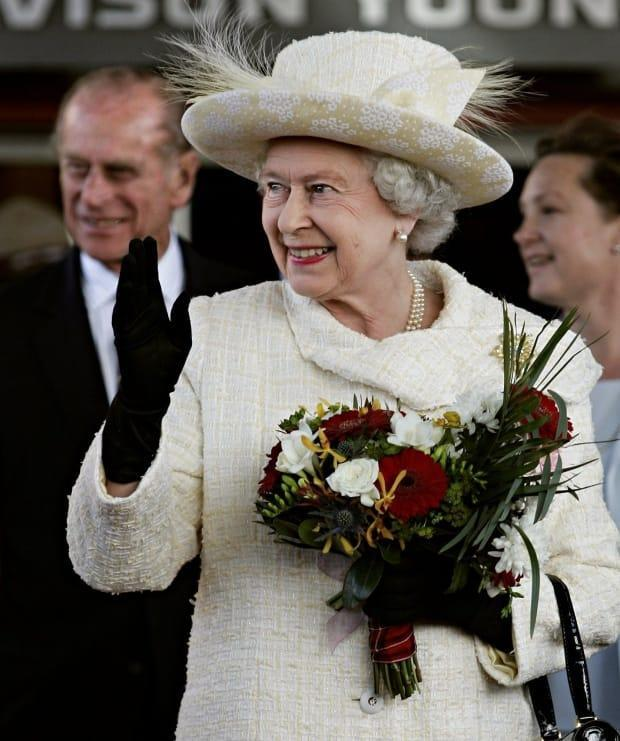Queen Elizabeth II waves to the crowd as she leaves the official departure ceremony at the Saddledome in Calgary Wednesday, May 25, 2005 followed by Prince Philip. The Queen was in Calgary following a nine-day tour to celebrate Alberta and Saskatchewan's centennial of their entry into Confederation. (CP PHOTO/Paul Chiasson)