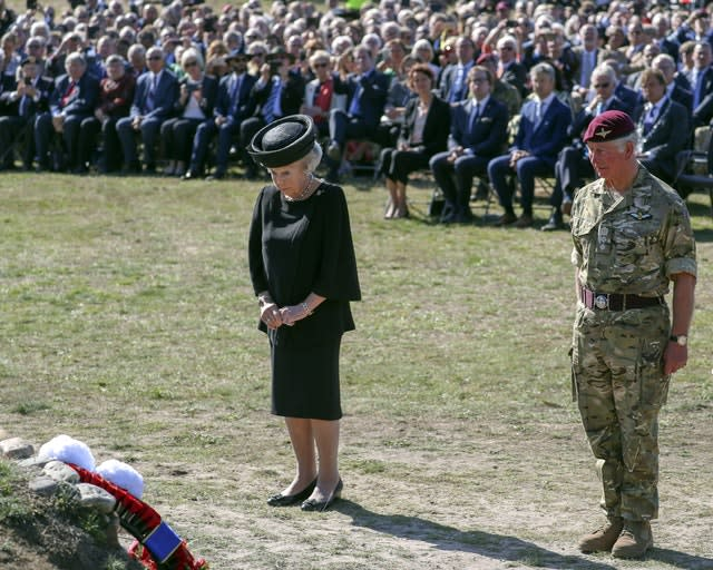 Prince Charles attends a commemorative service and wreath-laying with Princess Beatrix of The Netherlands