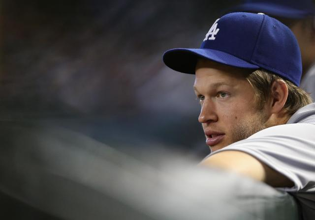PHOENIX, AZ - APRIL 13: Starting pitcher Clayton Kershaw #22 of the Los Angeles Dodgers watches from the dugout during the MLB game against the Arizona Diamondbacks at Chase Field on April 13, 2014 in Phoenix, Arizona. (Photo by Christian Petersen/Getty Images)