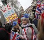 FILE - In this Friday, Jan. 31, 2020 file photo Brexiteers celebrate in London. Britain officially leaves the European Union on Friday after a debilitating political period that has bitterly divided the nation since the 2016 Brexit referendum. (AP Photo/Alastair Grant, File)