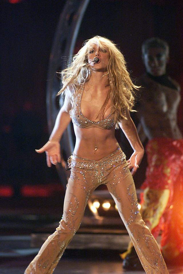 Britney's performance shocked audiences as she ripped off her suit to reveal a bejeweled naked outfit.