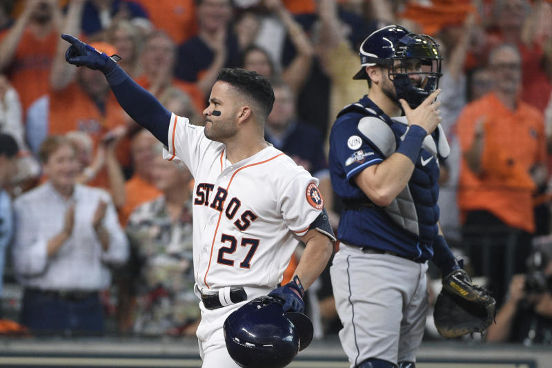 Houston Astros' Jose Altuve (27) celebrates after hitting a two-run home rung against the Tampa Bay Rays in the fifth inning during Game 1 in baseball's American League Division Series in Houston, Friday, Oct. 4, 2019.  (AP Photo/Michael Wyke)