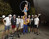 Fans pose with street performers. (PHOTO: Singapore GP)